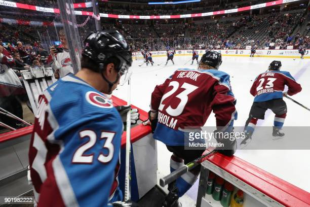 Nail Yakupov Anton Lindholm and Mark Barberio of the Colorado Avalanche take to the ice prior to the game in Milan Hejduk warm up jerseys at the...