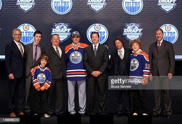 Nail Yakupov first overall pick by the Edmonton Oilers poses onstage with Oilers team representatives during Round One of the 2012 NHL Entry Draft at...