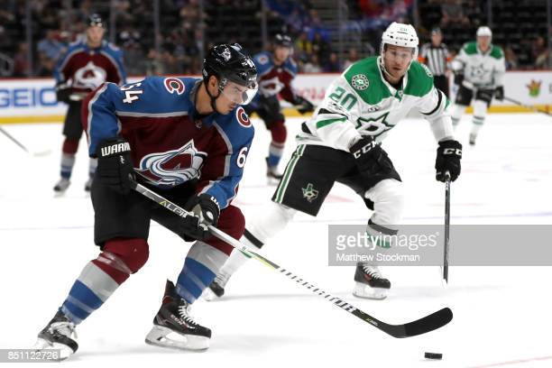 Nail Yakupov of the Colorado Avalanche advances the puck against Brian Flynn of the Dallas Stars at the Pepsi Center on September 21 2017 in Denver...