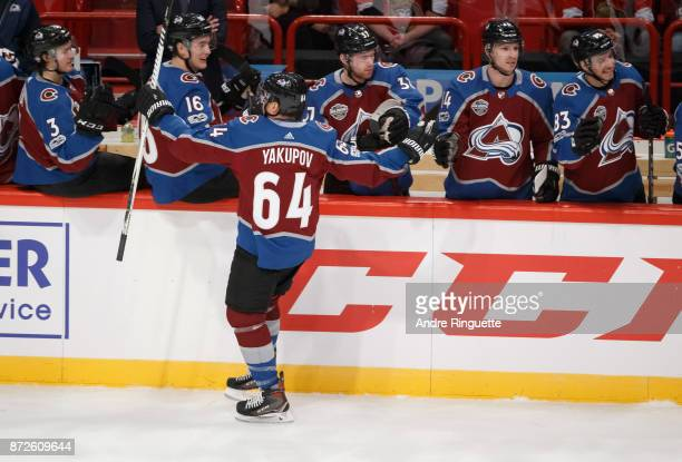 Nail Yakupov of the Colorado Avalanche celebrates his first period goal against the Ottawa Senators with teammates at the players bench at Ericsson...