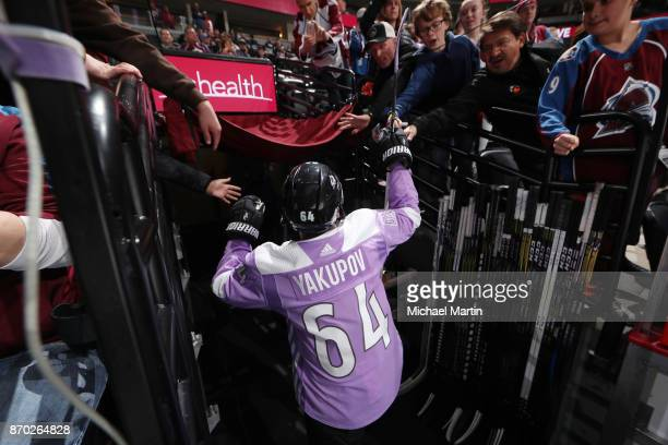 Nail Yakupov of the Colorado Avalanche greets fans after warm up prior to the game against the Carolina Hurricanes at the Pepsi Center on November 2...