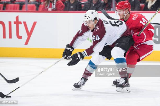 Nail Yakupov of the Colorado Avalanche skates with the puck in front of Gustav Nyquist of the Detroit Red Wings during an NHL game at Little Caesars...