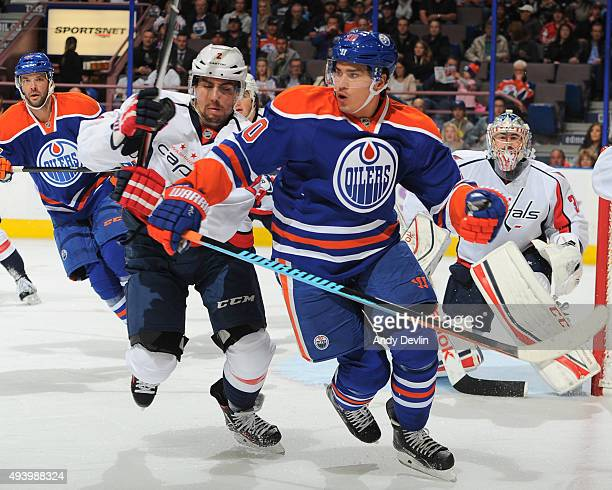 Nail Yakupov of the Edmonton Oilers battles for the puck against Matt Niskanen of the Washington Capitals on October 23 2015 at Rexall Place in...