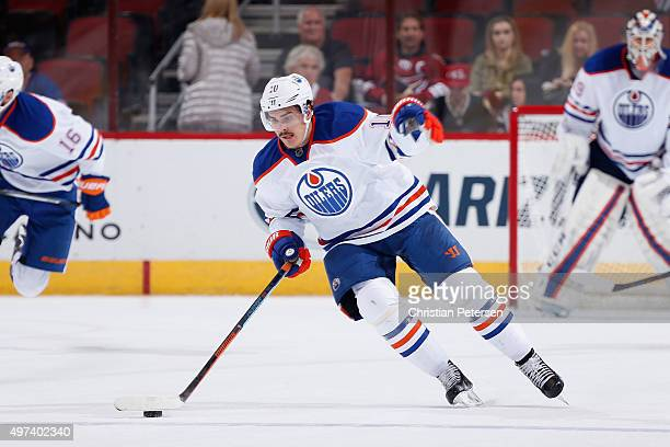 Nail Yakupov of the Edmonton Oilers skates with the puck during the NHL game against the Arizona Coyotes at Gila River Arena on November 12 2015 in...