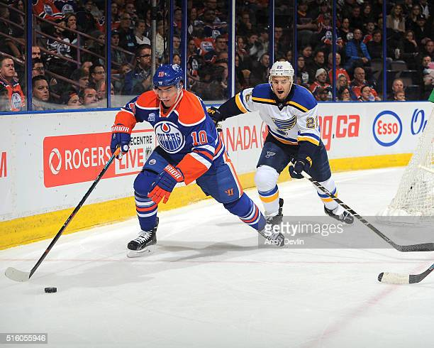 Nail Yakupov of the Edmonton Oilers skates with the puck while being pursued by Kevin Shattenkirk ofthe St Louis Blues on March 16 2016 at Rexall...