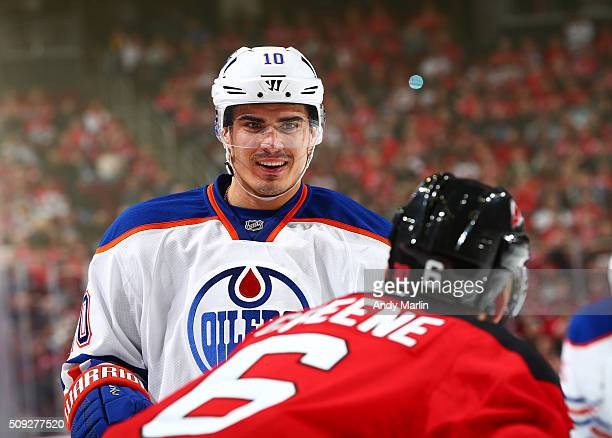 Nail Yakupov of the Edmonton Oilers talks to Andy Greene of the New Jersey Devils during the game at the Prudential Center on February 9 2016 in...
