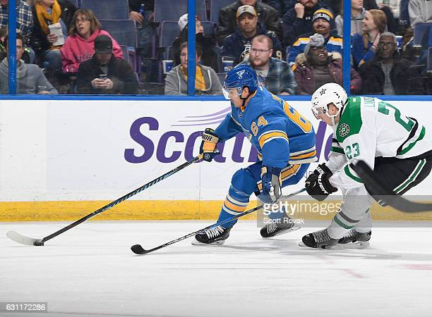 Nail Yakupov of the St Louis Blues handles the puck as Esa Lindell of the Dallas Stars pressures on January 7 2017 at Scottrade Center in St Louis...