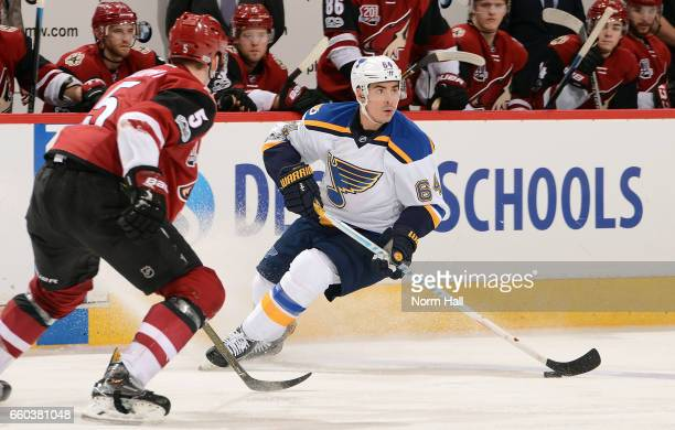 Nail Yakupov of the St Louis Blues skates with the puck in front of Connor Murphy of the Arizona Coyotes during the third period at Gila River Arena...