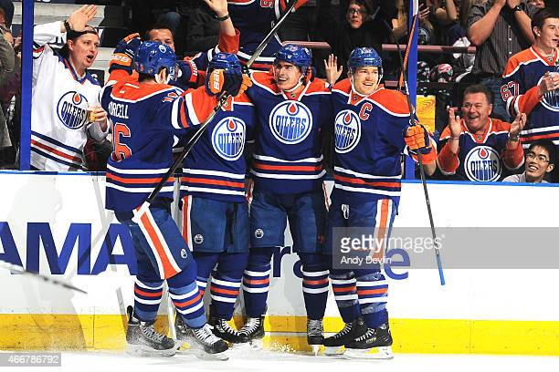 Nail Yakupov Teddy Purcell Derek Roy and Andrew Ference of the Edmonton Oilers celebrate after a goal during the game against the Columbus Blue...