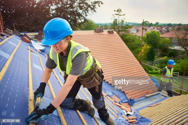 nailing the battens - rooftop stock pictures, royalty-free photos & images