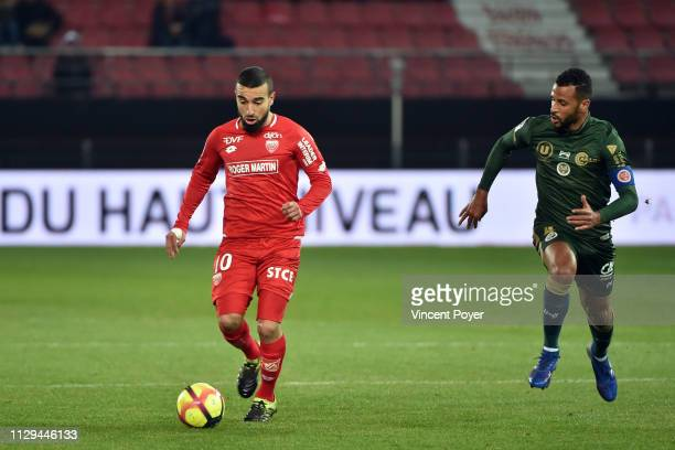 Naim SLITI of DFCO and ROMAO Alaixys of Stade de reims during the Ligue 1 match between Dijon and Reims at Stade Gaston Gerard on March 9 2019 in...