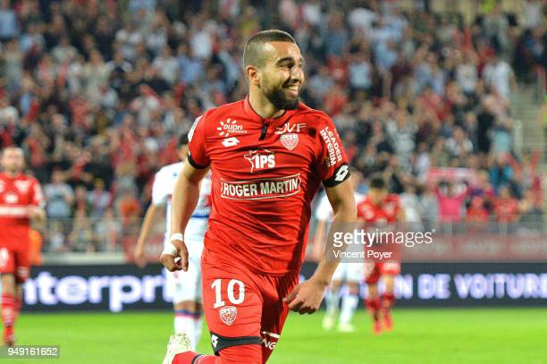 Naim SLITI of Dijon celebrates scoring during the Ligue 1 match between Dijon FCO and Olympique Lyonnais at Stade Gaston Gerard on April 20 2018 in...