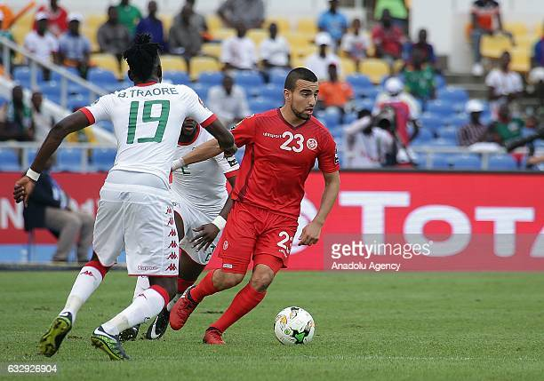 Naim Sliti of Tunisia vies with Bertrand Traore of Burkina Faso during the 2017 Africa Cup of Nations quarterfinal football match between Burkina...