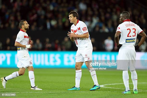Naim Sliti , Renato Civelli and Bakary Soumaoro of Lille during the Ligue 1 match between EA Guingamp and Lille OCS at Stade du Roudourou on October...