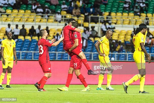 Naim Sliti Taha Khenissi and Hamdi Nagguez of Tunisia celebrates scoring during the African Nations Cup match between Zimbabwe and Tunisia on January...