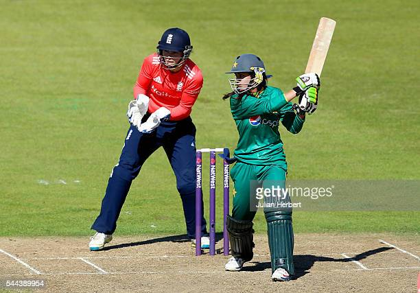 Nain Abidi of Pakistan hits out as Amy Jones of Englnd looks on during the 1st Natwest International T20 played between England Women and Pakistan...