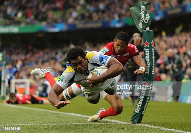 Naipolioni Nalaga of ASM Clermont Auvergne scores the opening try during the Heineken Cup final match between Clermont Auvergne and RC Toulon at the...