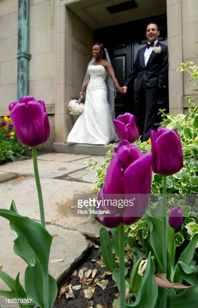 05/05/10 TORONTO ONTARIO Nairesiai and Adrian Morante have their wedding photos shot on the grounds of Osgoode Hall where flowers are in bloom in the...