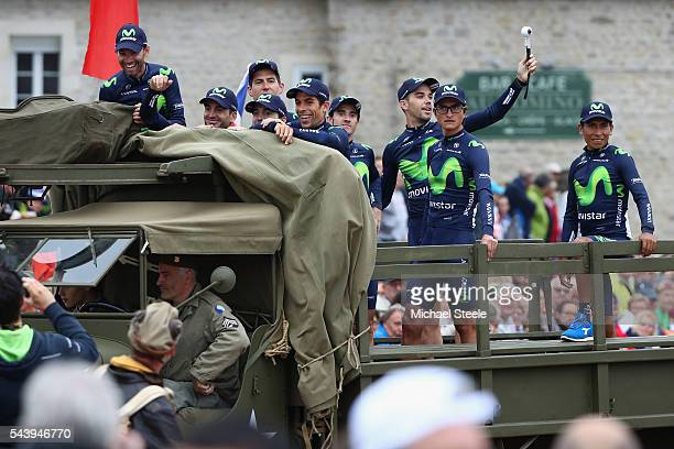 Nairo Quintana of Colombia and team leader of Movistar looks on as his team arrive in a first world war military vehicle during the team...