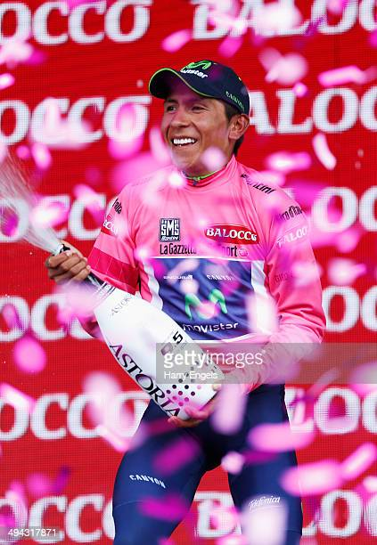 Nairo Quintana of Colombia and team Movistar celebrates retaining the Maglia Rosa leader's jersey following the eighteenth stage of the 2014 Giro...