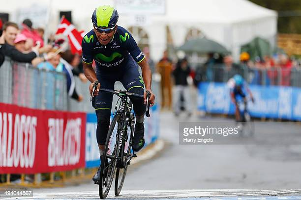 Nairo Quintana of Colombia and team Movistar crosses the line to win the sixteenth stage of the 2014 Giro d'Italia, a 139km high mountain stage...