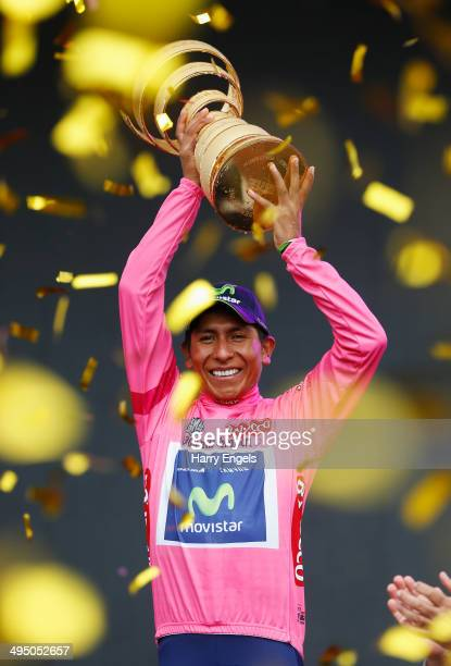 Nairo Quintana of Colombia and team Movistar lifts the winners trophy the 'Trofeo Senza Fine' following the twentyfirst stage of the 2014 Giro...