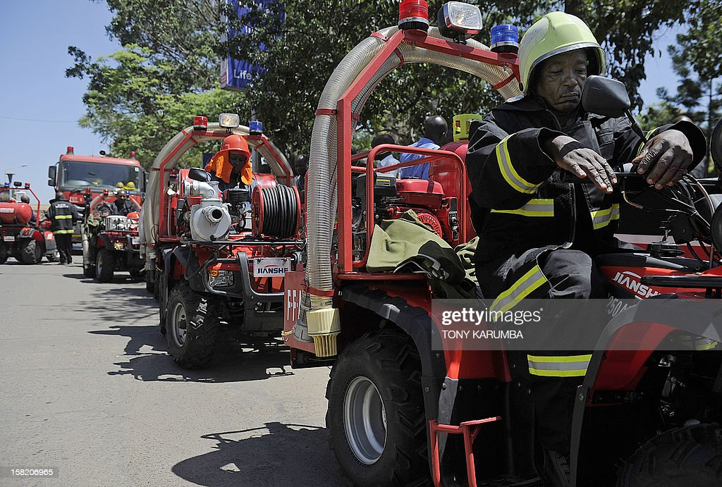 A Nairobi Fire Brigade serviceman sits on a a Fire Fighting All-Terrain-Vehicle (ATV) on December 11, 2012 in Nairobi which is the latest effort by the East African nation's government to beef up it's preparedness to respond to and curb fire, particularly in slums where fire outbreaks have in recent years claimed numerous lives and property due to their unregulated rapid growth making them less accessible to traditional fire fighting engines. At least 120 people burned to death when a pipeline burst into flames in a Nairobi slum in September 2011 as local people were siphoning fuel from it, and more than 100 were injured. AFP PHOTO/Tony KARUMBA