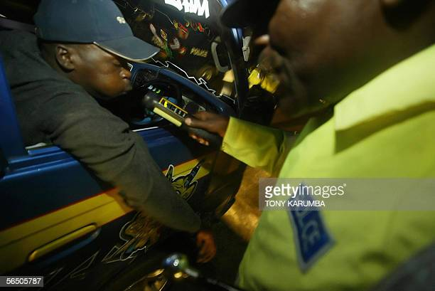 A Kenyan policeofficer tests the alcoholintake of a driver in this 23 December 2005 photo in Nairobi The use of the device marketed as Alcoblow by...