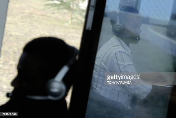 A picture taken 02 February 2006 shows telemarketers working at an international outsourcing call center in Nairobi No longer content to be known...