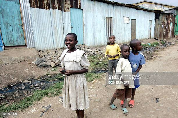 Children anxiously await the arrival of the United Nations Secretary General Ban Ki-moon to Kibera slum, Africa's largest slum, 30 January 2007 in...
