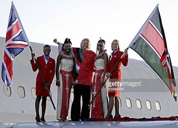 Founder of the Virgin group Sir Richard Branson poses with traditional dancers and air hostesses as he disembarkss from one of his planes 02 June...