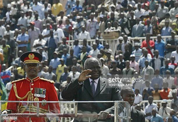 Kenyan President Mwai Kibaki waves as he arrives for the 42nd Jamhuri day celebrations commemorating Kenya's independence from Britain in Nairobi...
