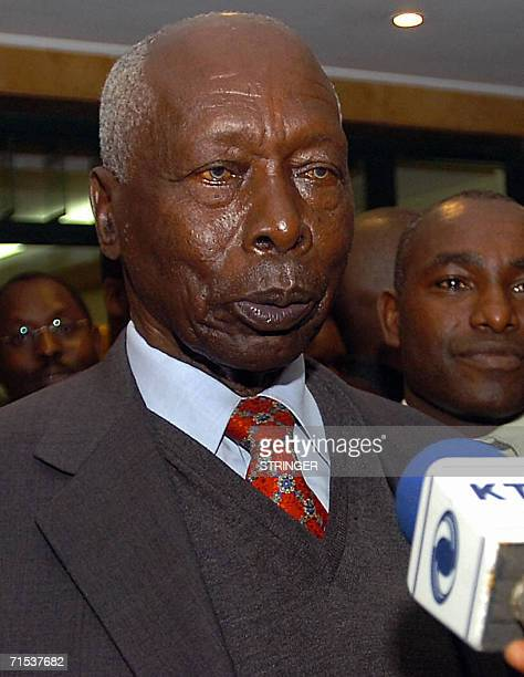 Kenya's former President Daniel Moi talks to the press after being discharged from the Nairobi hospital July 2006 where he underwent treatment for...