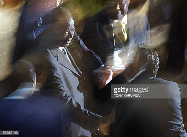 Kenya's President Mwai Kibaki arrives at the official opening of the 114th Assembly of the InterParliamentary Union 07 May 2006 in Nairobi Lawmakers...