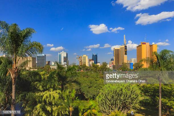 nairobi, kenya - looking across the park to the downtown jomo kenyatta avenue in the afternoon sunlight: nairobi skyline - nairobi stock pictures, royalty-free photos & images
