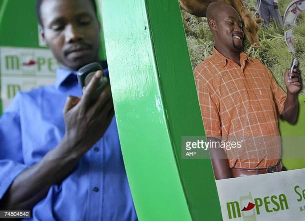 Photo taken 23 April 2007 shows A man sending money through a pioneering mobile phone service called MPesa in Kenya's capital NairobiMPesa [Pesa...