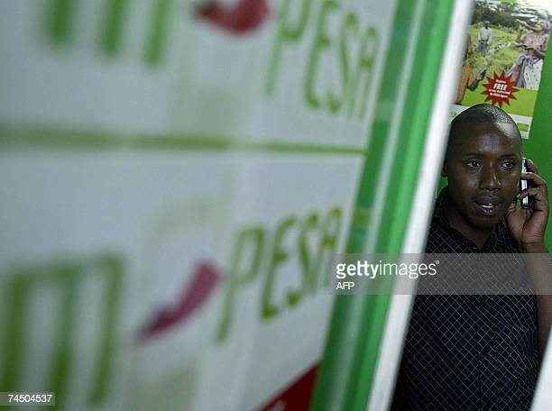 Photo taken 23 April 2007 shows a man talking into his mobile phone at an Mpesa shop A pioneering mobile phone service called MPesa in Kenya's...