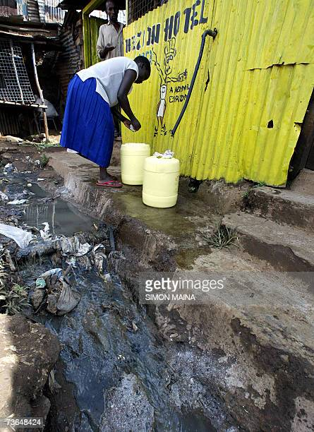 Residents collect water 21 March 2007 from a pipe in Nairobi's Kibera settlement one of the biggest slums in Africa that is home to about 800000...