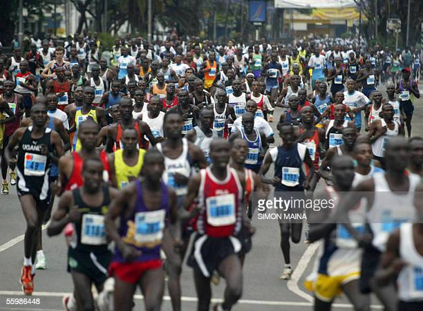 Runners participate in the Standard Chartered bank international marathon 23 October 2005 in Nairobi Thousands of entrants run the 42kilometre...
