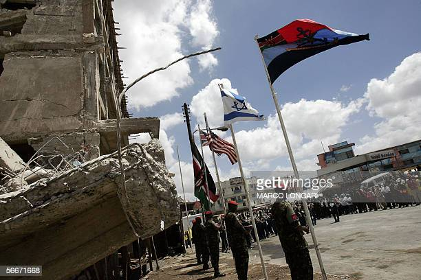 The flag of the Kenyan armed forces is seen together with Israeli British American and Kenyan 26 January 2006 during a commemoration ceremony for the...