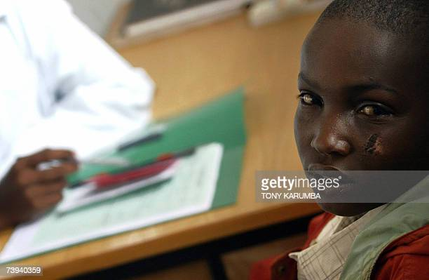 Young epileptic patient is seen by a doctor at a psychiatric centre in one of Nairobi's shantytowns, Kangemi in this 11, April 2007 photo. The centre...