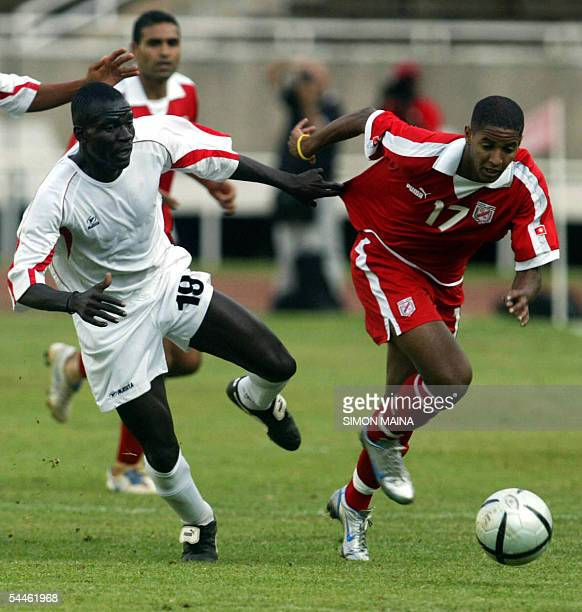 Tunisia's Issa Njemmar fights for the ball with Kenya's Ali Breik during their Group 5 African Zone 2006 World Cup qualifying match at the Moi...