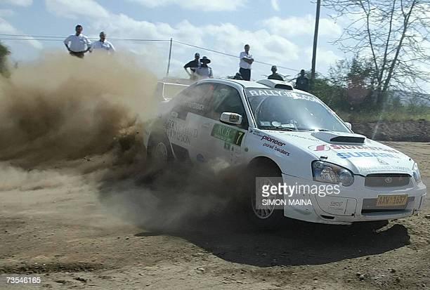 Zimbabwean Conrad Rautenbach and codriver Peter Marsh drive a Subaru Impreza in Athi river 11 March 2007 to win the country's Safari Rally held in...