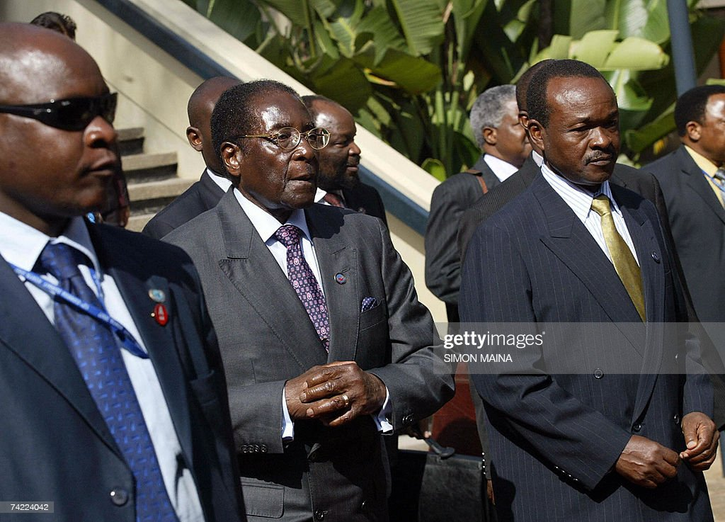 Zimbabwe's president Robert Mugabe (C) arrives on the second day to attend the 12th two-day summit of the Common Market for Eastern and Southern Africa (COMESA) 23 May 2007 at the UN headquarters in Nairobi. The heads of state and government are due to approve important steps toward customs union, set to be launched next year, after their trade ministers last week agreed on a common external tariff deal.