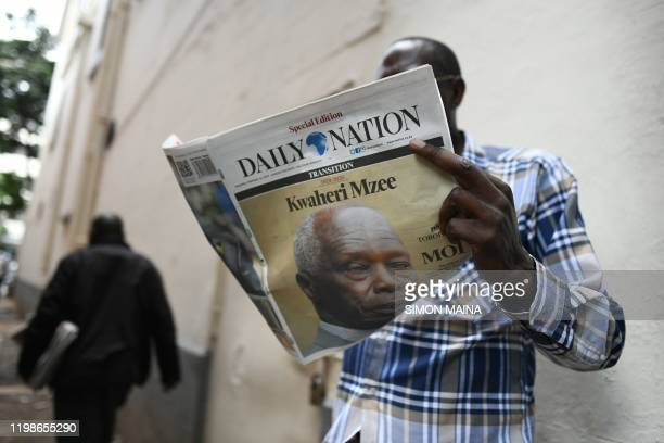 A Nairobi resident reads a local newspaper which covers reads goodbye old man in tribute to former Kenya's president Daniel Arap Moi in Nairobi on...