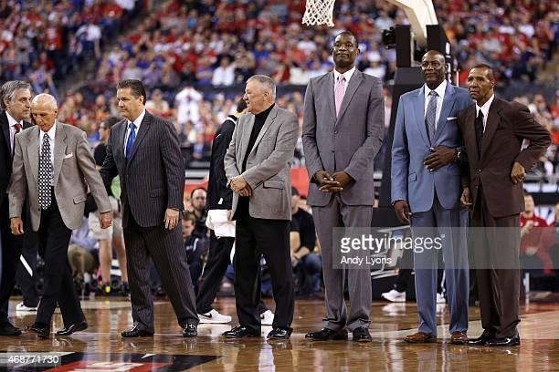 2015 Naismith Hall of Fame Inductees Dick Bavetta John Calipari Louis Dampier Dikembe Mutombo Spencer Haywood and Jo Jo White on the court during the...