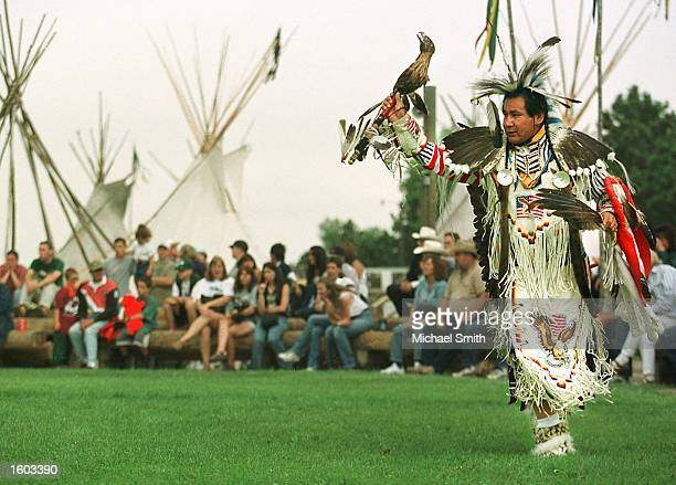 Naitive American in ceremonial dress dances during Cheyenne Frontier Days July 23 2001 in Cheyenne WY Frontier Days feature the largest outdoor rodeo...