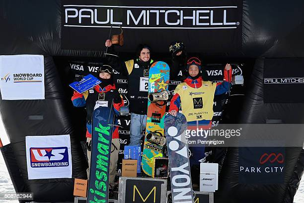 Naito Ando of Japan in third place Matthew Ladley in first place and Ryo Aono of Japan in second place celebrate on the podium in the men's FIS...