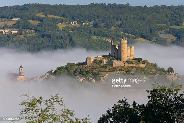 najac castle above mist covered najac village in france - aveyron stock pictures, royalty-free photos & images