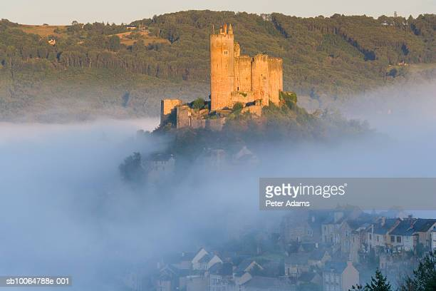 Najac Castle in morning mist